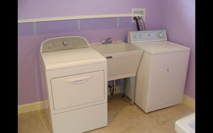 Finished Basement with Laundry Space | Sovereign Construction Services